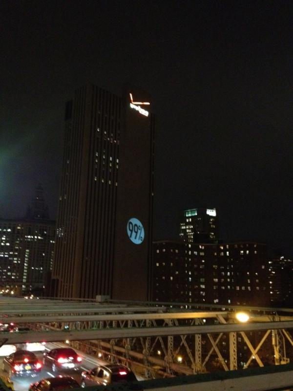 Aefgr3lCIAAU9xq Better Than the Bat Signal: Occupy Wall Street Project 99% onto Verizon Building